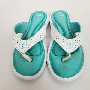 Nike teal and white flip flops